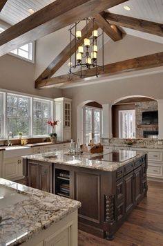 Kitchen with two different colored cabinets. Love the huge island with light colored granite countertops. So open and airy!