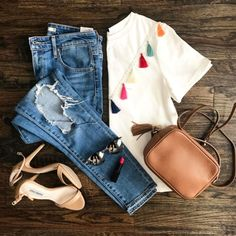 The Miller Affect flat lay with a white tassel tee