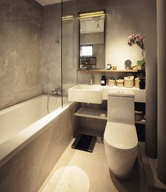 Beautiful hotel inspired modern bathroom design | white sink | concrete & wood materials