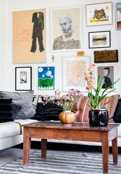 Go all in on a personal gallery wall with homemade pictures and paintings.