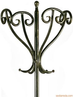 Antique Standing Coat Rack | Tour - Detail of the wrought-iron coat stand…
