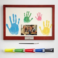 Family handprint frame  http://gifts.redenvelope.com/gifts/family-handprint-frame-30002402?ref=HomeNoRef&viewpos;=21&trackingpgroup;=rhmbs