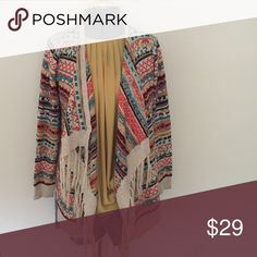 Colorful Fringe Sweater Colorful patterned sweater. Fringe bottom details. One size- would fit a small or medium oversized. No flaws. Price firm. ✨ ships within 24 hours of purchase ✨ Free People Sweaters Cardigans