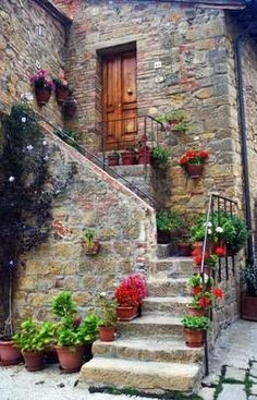 Monticchiello, Tuscany  stairs to the stone home filled with flowers
