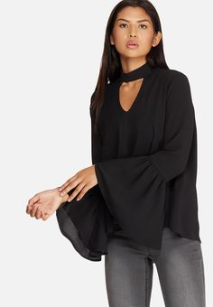 This beautiful blouse has subtle details that can be seen in the bell sleeves and keyhole cutouts on front and back. Semi sheer and lightweight in its fabrication, this top will pair well with anything from a midi skirt to skinny jeans. Bell Sleeves, Bell Sleeve Top, Beautiful Blouses, Black Blouse, Midi Skirt, Ruffle Blouse, Skinny Jeans, Skirts, Fabric