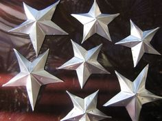 Tin stars from soda cans.  The tutorial is here:  www.craftster.org... (Maybe cover with plastic dip?) # by rhonda
