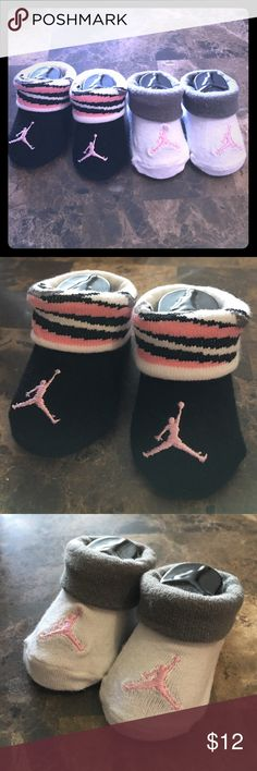 Newborn infant booties Air Jordan's Every baby needs a pair of Air Jordan's, these are super cute! It's a set of 2 pairs, first is a pair of black with pink logo and white black and pink accents on the fold and the other a white bootie base with pink Logo and grey fold. New never been worn, no box. Make an offer! Jordan Shoes Baby & Walker