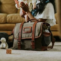 From the outside, the Denver Waxed Canvas Diaper Bag looks nothing like a men's diaper bag. Dad Diaper Bag, Best Diaper Bag, Waxed Canvas Bag, Canvas Bags, Leather Diaper Bags, Leather Bags, Hipster Backpack, Diaper Parties, Best Gifts For Men