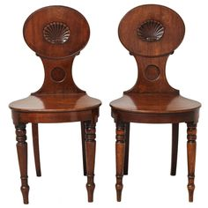 Pair of English Regency Mahogany Hall Chairs | From a unique collection of antique and modern side chairs at https://www.1stdibs.com/furniture/seating/side-chairs/