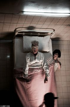 Spooky: The Ziggy Stardust hitmaker can be seen writhing around in a hospital bed, with bandages covering his eyes as he's tormented by evil spirits