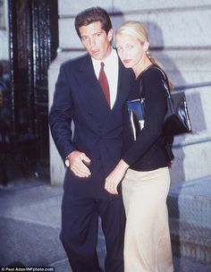 John F. Kennedy Jr and wife Carolyn Bessette are pictured here ...