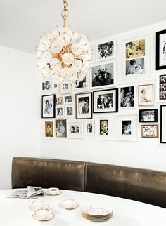 Dining nook with mod chandelier and family photo wall via @cocokelley