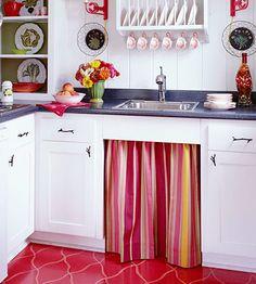 Striped skirt on kitchen sink base. Adorable!