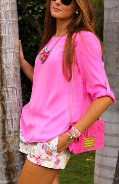 Pretty in pink.  Floral print fitted shorts with a beautiful relaxed fit, three quarter sleeve pink blouse.   Great for spring or summer casual street wear.