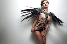 Spiked Sexy Couture Shoulder Coque Feather Epaulets lolita futuristic lady gaga steampunk avant garde. via Etsy.