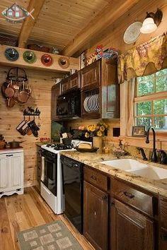 In this 24'x24' log cabin, maximizing kitchen space was a priority, but did not compromise the beauty of the home.