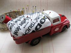 Cathe Holden - JSIM --- adorable pin cushion. Now I just need a proper old truck or something....hmmmm
