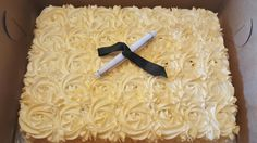 Graduation Cakes with Gold Spray Rosettes