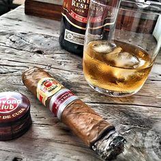 """Havana Club Anejo Reserva rum (""""El Ron de Cuba"""") and a Diplomáticos Exclusivo Paises Bajos Petit Robustos Cuban cigar."""