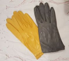 """VINTAGE GLOVES $21 Sharpsburg  FOR SALE VINTAGE GLOVES 2 PAIRS KID LEATHER L to R: #1: (SOLD) SZ 6-1/2...would fit SZ 6 as they are NEW... Miss Aris brand. Fits middle finger 3"""" or a tad beyond, super buttery soft kid in a wonderful statement shade of yellow/gold, Made in Philippines, wrist length with scalloped edge trim, center notch. Unlined. 32.50 #2: SZ 6 to 6-1/2, Fits middle finger less than 3"""", so slightly shorter fingers. Buttery soft medium grey kid leather. Silky lining, classic…"""