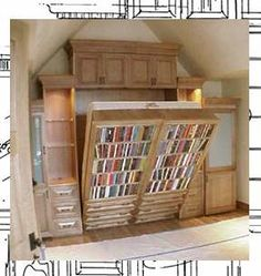 Murphy bed bookshelf.  Brilliant!  But how do the books stay on the shelves?