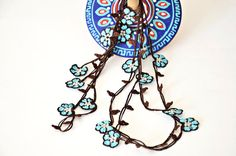 Turguoise jewelry, wrap crochet necklace, oya beaded lariat. Turquoise flowers with pearl beads on brown skeleton crochet necklace. Completely hand crocheted oya. The leaves are in dark brown colors and the flowers are turquoise blue with small pearl beads at the centers. There is no metal
