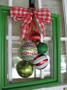 Upcycle your old frame with a little paint and Christmas embellishments.