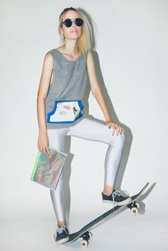 hologram clutch bag with vivid yellow faux fur and grey mickey mouse double tank top with double kangaroo pocket