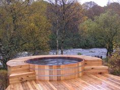 A hot tub is nothing more than a tub full of hot water. A hot tub may come with massaging jets, whirlpools, water pumps, heating and filtering systems, etc. Jacuzzi is a company that manufactures hot tubs. Hot Tub Backyard, Backyard Water Feature, Backyard Kitchen, Whirlpool Deck, Wood Tub, Saunas, Log Cabin Homes, Log Cabins, Design Hotel
