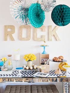 Host a fun Rock n' Roll themed party for your friends using your favorite colors and records as decor! Perfect for a birthday party, Grammys, or new years' eve party!