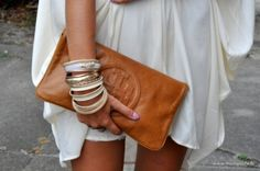 Neutral brown leather clutch, bangles flowing white classic