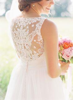 lace wedding dress back detail, photo by Cassidy Carson http://ruffledblog.com/louisiana-backyard-wedding #weddingdress #weddinggown #lacedress