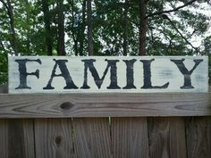 """Family by CreateYourWoodSign.com  Hand painted wood sign  The size is 30"""" by 6""""  The background is cream with black under the cream with black lettering  The font is weathered sf  Distressed   Without outdoor protection  No border   Our wooden plaques are created for enduring quality. Because we never use vinyl stickers on our wooden signs, you can expect the writing to last forever."""