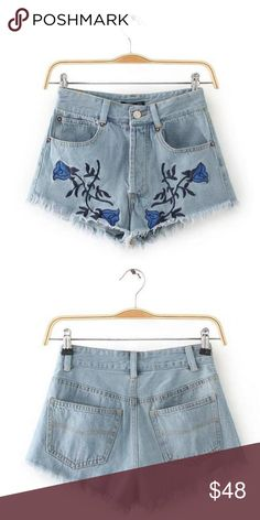 "Embroidered Floral Cut-Off Shorts zipper closure, high waisted style, royal blue floral embroidery, cotton/polyester blend, light washed denim design, measurements: coming soon  RESERVE out of stock sizes by purchasing any ""arriving"" option & it will automatically ship to you when its restocked. If you choose not to reserve, please be patient, priority stock goes to reserves first, then what is left will reflect in my closet Shorts Jean Shorts"