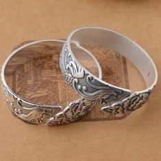 Silver Phoenix Bangle, handcrafted from sterling silver and available at https://takumiarts.com Fine Japanese Jewelry from myths and legends : Dragon, Phoenix, Maneki Neko, Koi Carp, Sakura flowers, Youkai and much more. Handcrafted from sterling silver, pure silver and 18k gold. Free shipping and worry-free returns.