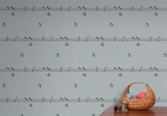 On a Wire - Sniff - Earth Inke Wallpapers - A delightful summer fresh design, showing birds - swallows sat on wires, creating stripe effect. Shown in the Sniff grey colourway.