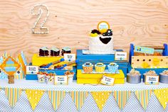 Construction Crew Boy Birthday Dessert Table Overall. I like the plywood backdrop & the use of tools in this one.