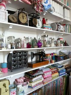 Bottles and jars, antique scales, antique sewing machines, vintage trims and buttons and of course FABRIC!