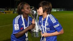 4 October 2015: ENIOLA ALUKO and JI SO-YUN give the FA WSL trophy a long-awaited kiss after a 4-0 victory over Sunderland secured the title for the CHELSEA LADIES...