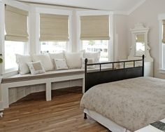 Gorgeous Beach Style Bedroom With Bay Window Bench Also Natural Laminate Floor Design And Classic Black Footboard Also Double Size Bed With White Cuishions Color With Traditional Curtains Material Beautiful Beach Style Bedroom Design Ideas