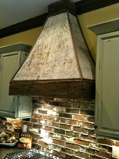 vintage tin ceiling tiles on kitchen stove hood