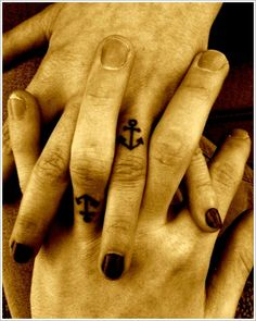 Tattoo Designs For Couple: The Anchor Tattoo Designs And Meaning For Married Couples On Finger ~ tattooeve.com Tattoo Design Inspiration ring tattoos, ring finger, finger tattoos, anchor tattoos, tattoo patterns, matching tattoos, a tattoo, wedding rings, couple tattoos