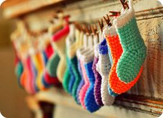 tiny colorful crochet stockings - I love how this looks, Crochet Crafts, Crochet Yarn, Yarn Crafts, Crochet Projects, Crochet Bunting, Crochet Garland, Crochet Stocking, Stocking Stuffers For Kids, Holiday Crochet