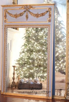 It is all in the details... a beautiful gilded French mirror -  Something old, something new   Something French...         something French blue.     Do you think...