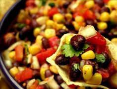 Healthy and quick- we love it! 15 minute Black Bean and Corn Salsa - Rotel canned tomatoes, corn, black beans, onion, cilantro, and lime juice.
