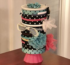 Made this for my granddaughter . . . pinterest idea  made from oatmeal container ,brushes and hair bows can be stored inside