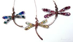 Wire wrapped copper dragonflies pedants with czech glass beads. They shimmers with every single ray of light :)  www.etsy.com/shop/InwardArt