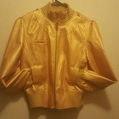 Metallic Gold RocaWear Faux Soft Leather Jacket Perfect accessory for the girl who loves to take fashion risks and be flashy sometimes. Purchased for a client photoshoot and it didn't fit. There is a rip on the inside lining that is not noticeable on the outside. Contact me with any more questions! Rocawear Jackets & Coats