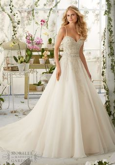 Wedding Dresses and Wedding Gowns by Morilee featuring Crystal Beaded Embroidery Cascades onto the Organza Ball Gown with Shoestring Straps Removable Beaded Satin Belt. Colors available: White/Silver, Ivory/Silver, Ivory/Light Gold/Silver, Ivory/Blush/Silver.