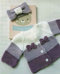 Cardigan and bow for baby worked in garter stitch, using shades of purple. - - Cardigan and bow for baby worked in garter stitch, using shades of purple. – Cardigan and bow for baby worked in garter stitch, using shades of purple. Cardigan Bebe, Knitted Baby Cardigan, Purple Cardigan, Knit Vest, Purple Dress, Baby Girl Crochet, Crochet Baby Clothes, Baby Knitting Patterns, Baby Patterns